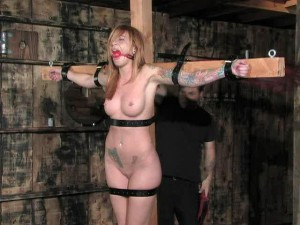 Girl in cross and bondage confirm