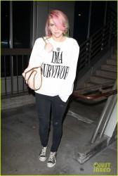 Kesha - arriving back to in LA 3/6/14