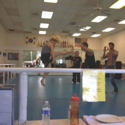 Emily Osment Practicing Martial Arts at a Gym