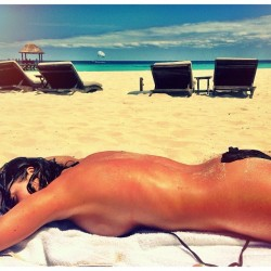 Kelly Monaco Sunbathing at the Beach - April 25, 2014