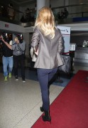 Rosie Huntington-Whiteley - at LAX Airport in LA - 04/24/14