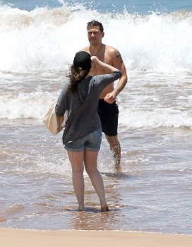 Kat Dennings - in shorts at a beach in Maui 05/01/2014