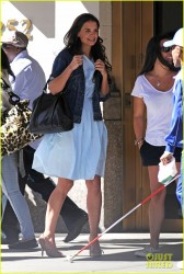 Katie Holmes laughs as the wind tries to blow up her dress out and about in New York 8/24/13