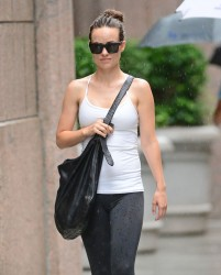 Olivia Wilde walking in the rain in New York City on July 16, 2014