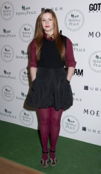 Amber Tamblyn nice legs in purple pantyhose at the 7th Annual Peace Market at the Metropolitan Pavillion 3/1/12
