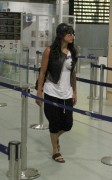 Michelle Rodriguez Walking through Ibiza Airport 14-2014 x14