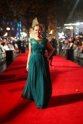 "Tanya Burr slightly wet in elegant dress at the world premiere of 'The Hunger Games: Catching Fire"" 11/11/13"