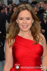 Tanya Burr gets windblown in a elegant silk red dress at the Iron Man 3 UK premiere held at the Odeon Leicester Square 4/18/13