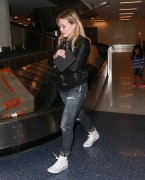 *ADDS* Hilary Duff in jeans arrives at LAX Airport 10/15/14