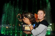 Maria Sharapova Poses with the winners trophy of the 2014 China Open October 5-2014 x3