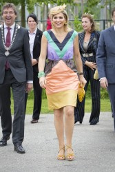 Queen Maxima rides a bike in a dress and heels at the opening of the Maxima Park in Utrecht 7/5/13