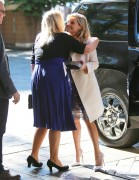 Reese Witherspoon greets friends while arriving at the Beverly Hilton Hotel November 21-2014 x24