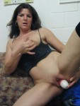 milf putting a toy in her pussy