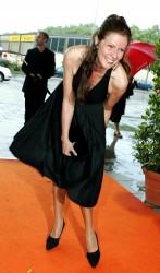 Leonore Capell lifting up her dress and showing her hose and underwear arriving at the musical premiere of 'Saturday Night Fever' in Munich 8/7/04