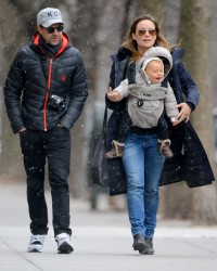 Olivia Wilde and her fiance Jason Sudeikis take baby Otis on a snowy walk in Brooklyn, NY - March 28, 2015
